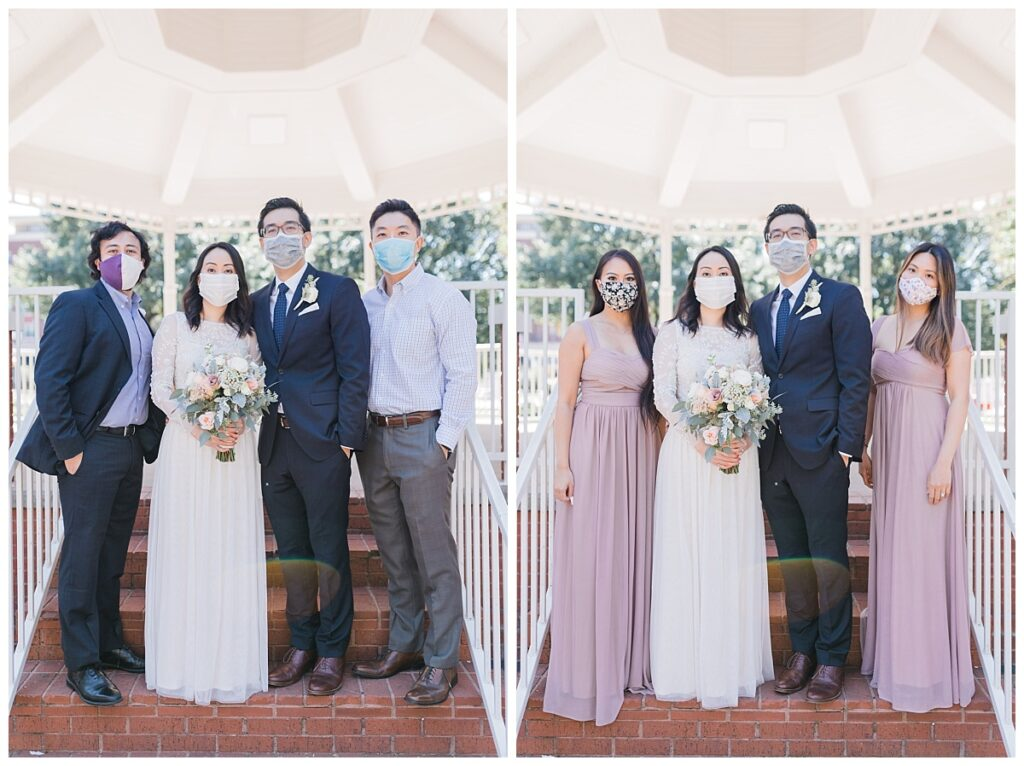 Bride in elegant, white minimal wedding dress and groom poses with bridesmaid and groomsmen under gazebo at Haggard Park in Plano, TX for bridal party portraits by wedding photographer Jenny Bui of Picture Bouquet Studio, a Dallas based wedding photography studio.