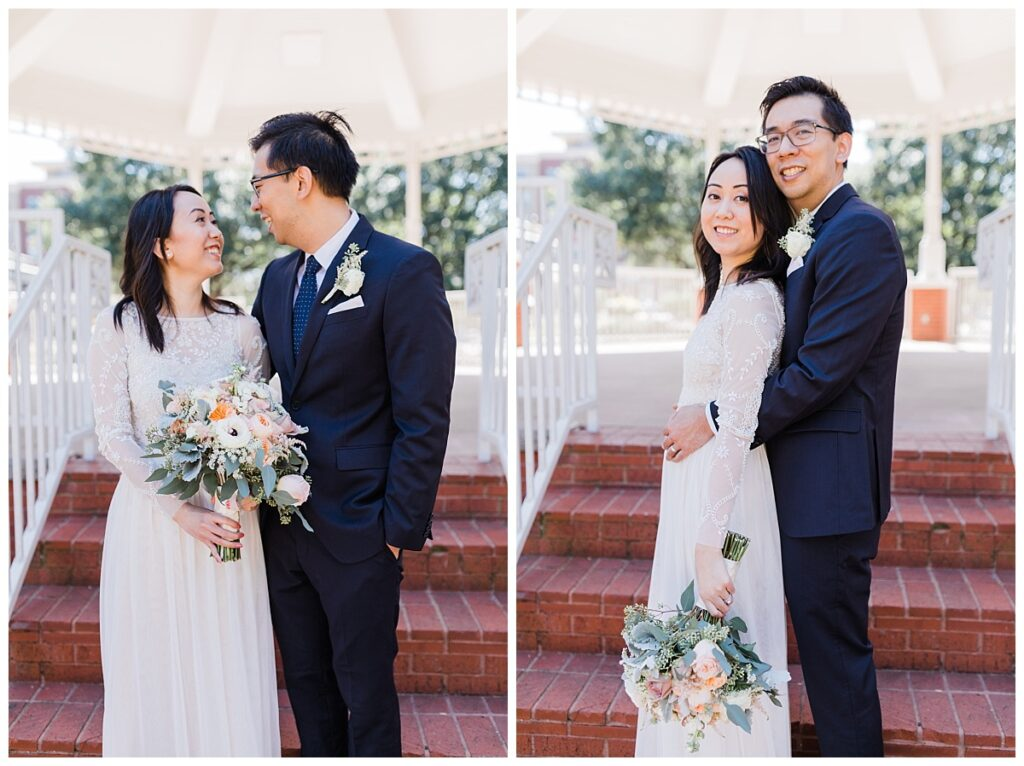 Bride in elegant, lace white wedding dress poses with groom in navy suit under gazebo at Haggard Park in Plano, TX for bridal party portraits by wedding photographer Jenny Bui of Picture Bouquet Studio, a Dallas based wedding photography studio.
