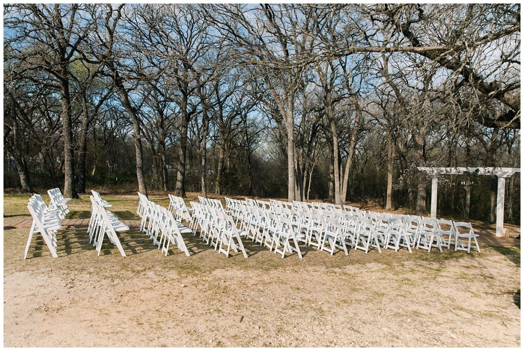 Chair setup for outdoor Texas styled wedding at Fort Worth Country Memorial Wedding Venue photographed by Dallas wedding photographer Jenny Bui of Picture Bouquet Studio.