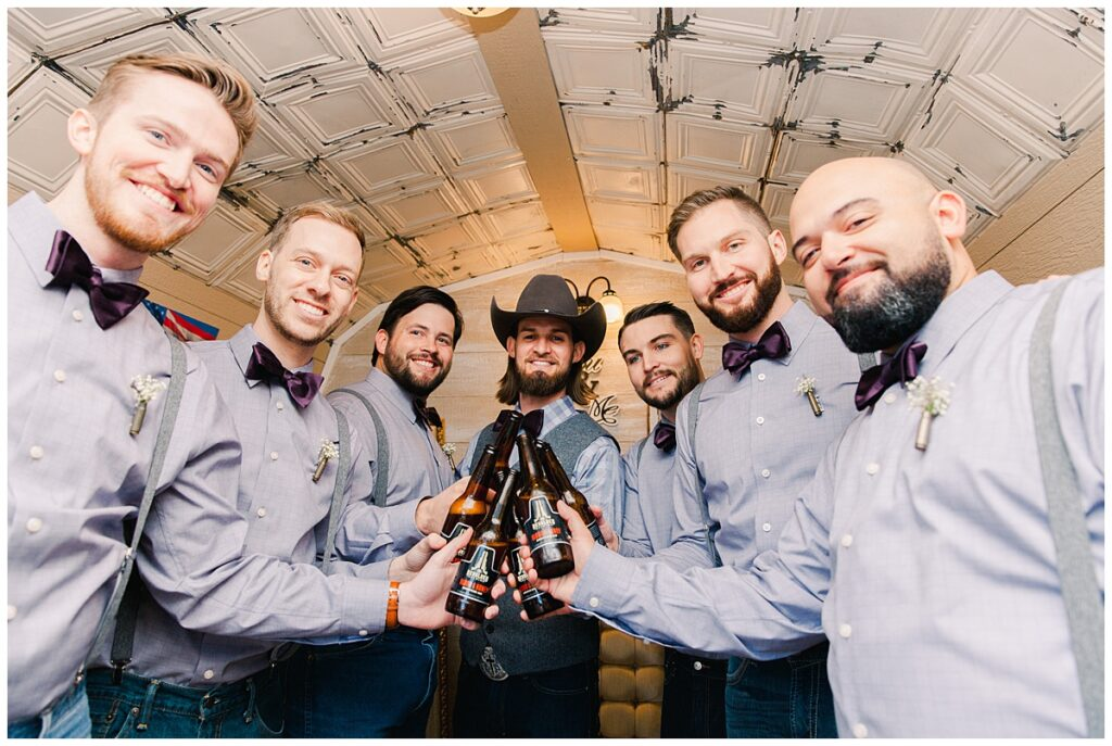 Groomsmen with groom for outdoor Texas styled wedding at Fort Worth Country Memorial Wedding Venue photographed by Dallas wedding photographer Jenny Bui of Picture Bouquet Studio.