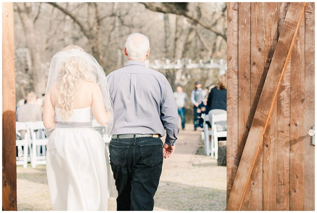 Texas styled bride walking with father down the aisle for outdoor Texas styled wedding at Fort Worth Country Memorial Wedding Venue photographed by Dallas wedding photographer Jenny Bui of Picture Bouquet Studio.