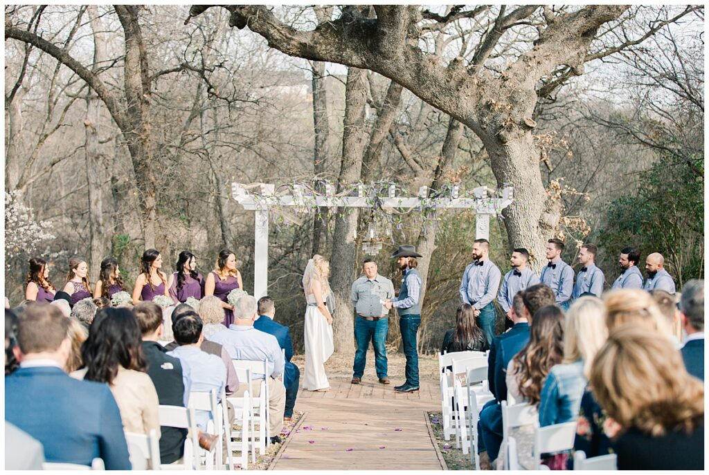 Wedding ceremony for outdoor Texas styled wedding at Fort Worth Country Memorial Wedding Venue photographed by Dallas wedding photographer Jenny Bui of Picture Bouquet Studio.