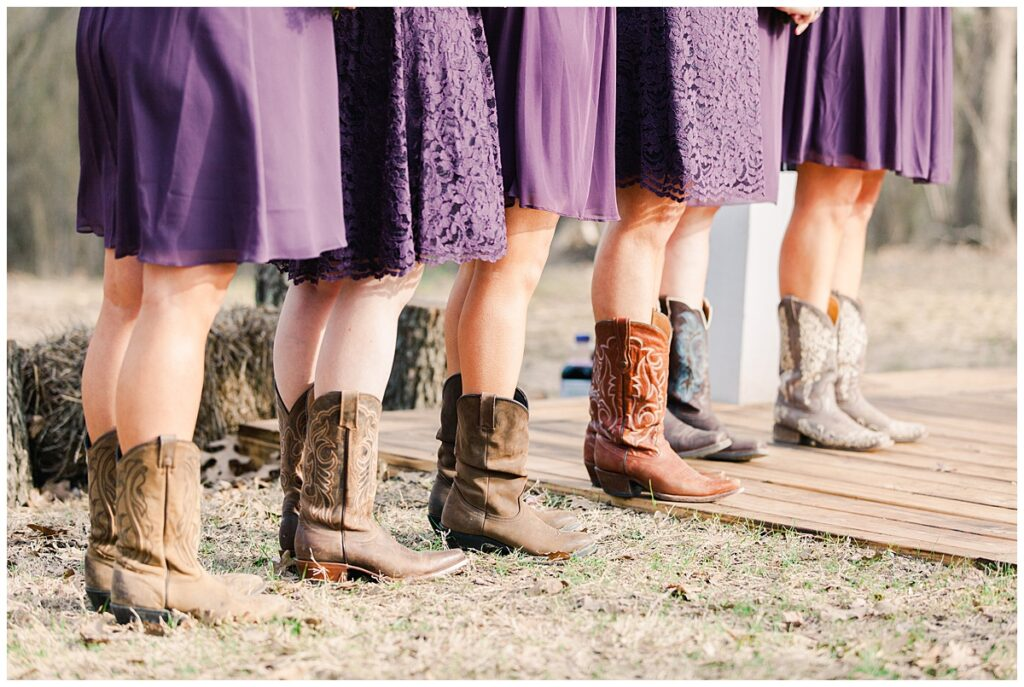 Bridesmaids cowboy boots for outdoor Texas styled wedding at Fort Worth Country Memorial Wedding Venue photographed by Dallas wedding photographer Jenny Bui of Picture Bouquet Studio.
