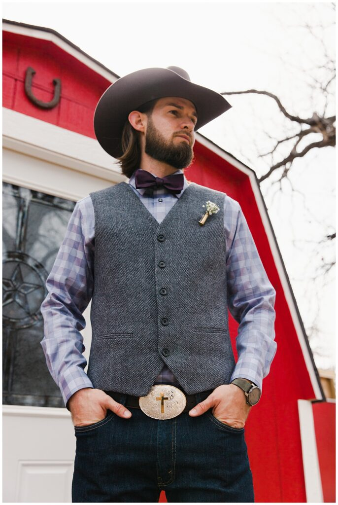 Groom poses with hand in pocket for outdoor Texas styled wedding at Fort Worth Country Memorial Wedding Venue photographed by Dallas wedding photographer Jenny Bui of Picture Bouquet Studio.
