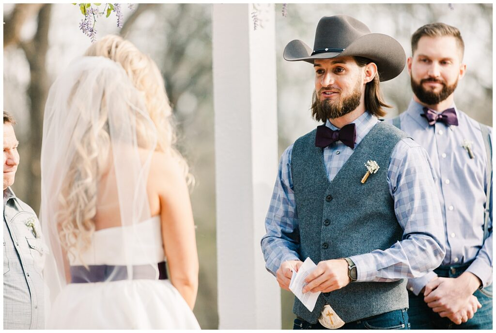 Groom reading vows for outdoor Texas styled wedding at Fort Worth Country Memorial Wedding Venue photographed by Dallas wedding photographer Jenny Bui of Picture Bouquet Studio.
