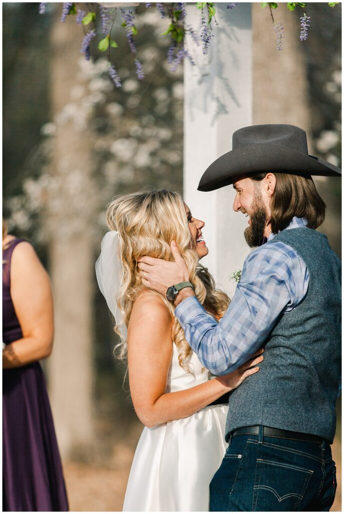 Texas styled bride and groom stares at one another after first kiss for outdoor Texas styled wedding at Fort Worth Country Memorial Wedding Venue photographed by Dallas wedding photographer Jenny Bui of Picture Bouquet Studio.