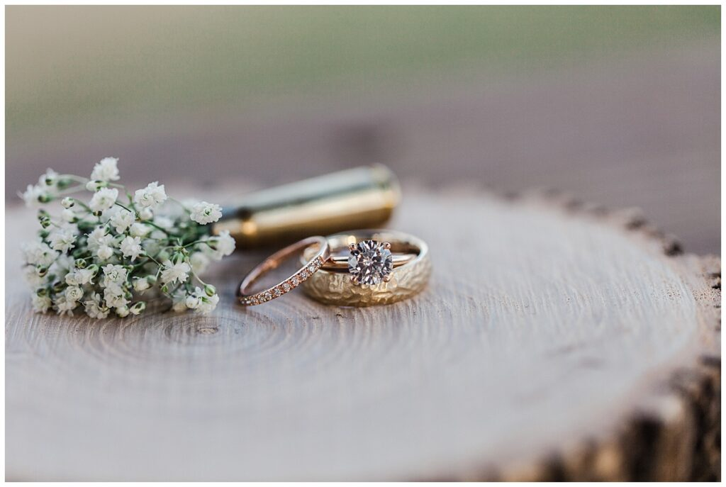 Ring shot of rings for outdoor Texas styled wedding at Fort Worth Country Memorial Wedding Venue photographed by Dallas wedding photographer Jenny Bui of Picture Bouquet Studio.