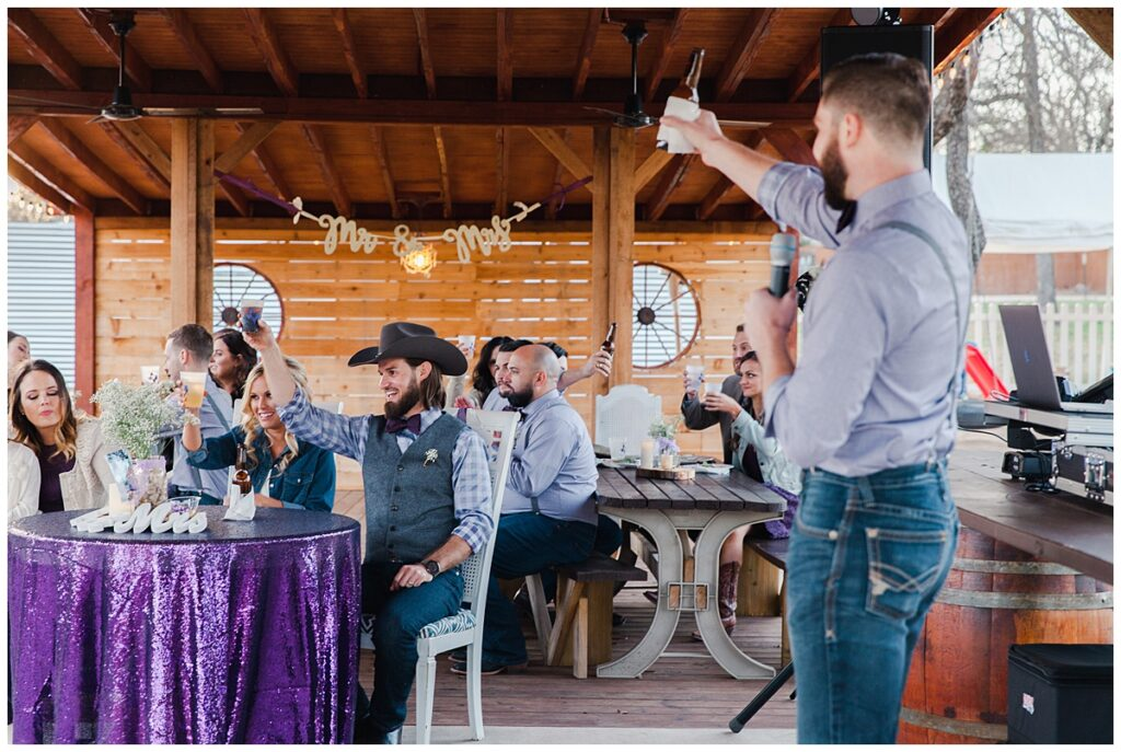 Best man's speech for outdoor Texas styled wedding at Fort Worth Country Memorial Wedding Venue photographed by Dallas wedding photographer Jenny Bui of Picture Bouquet Studio.