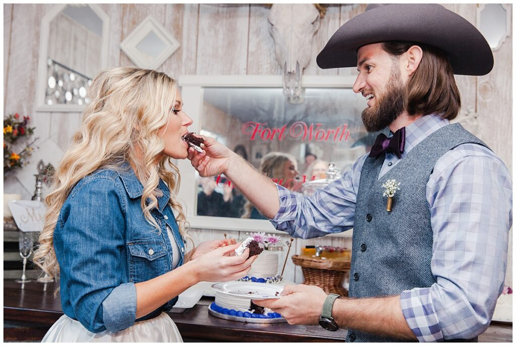 Groom feeding bride cake for outdoor Texas styled wedding at Fort Worth Country Memorial Wedding Venue photographed by Dallas wedding photographer Jenny Bui of Picture Bouquet Studio.
