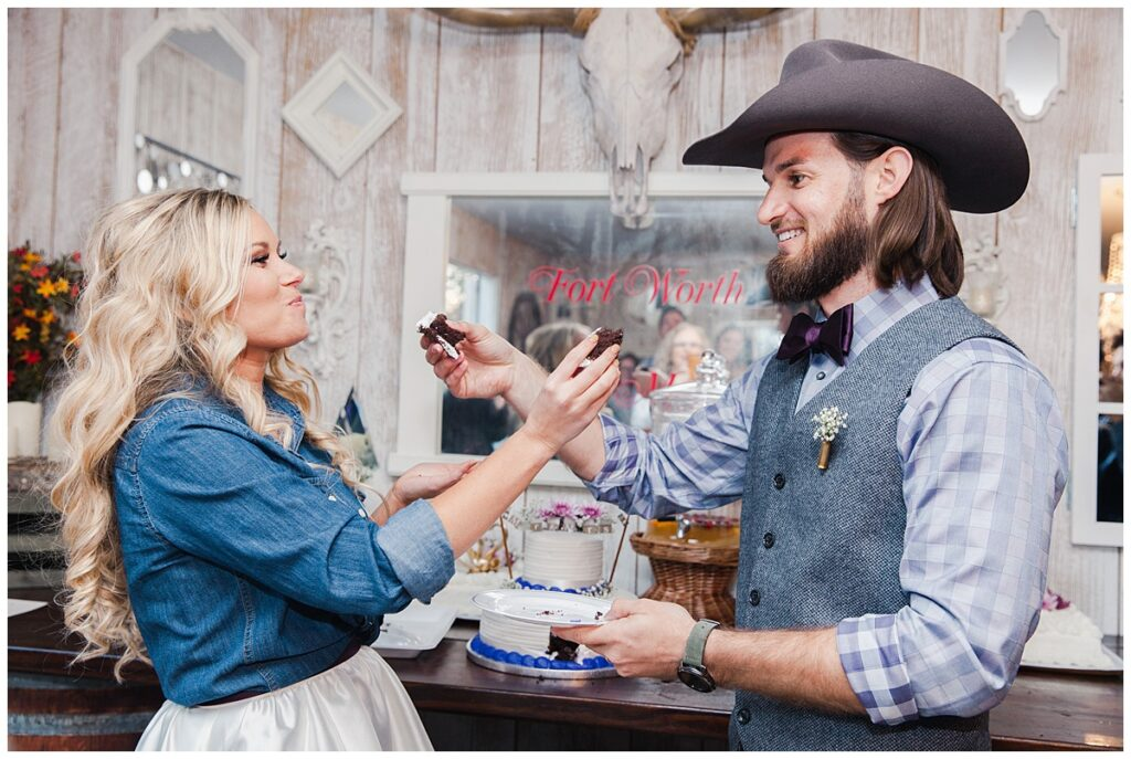 Bride and groom feeding one another for outdoor Texas styled wedding at Fort Worth Country Memorial Wedding Venue photographed by Dallas wedding photographer Jenny Bui of Picture Bouquet Studio.