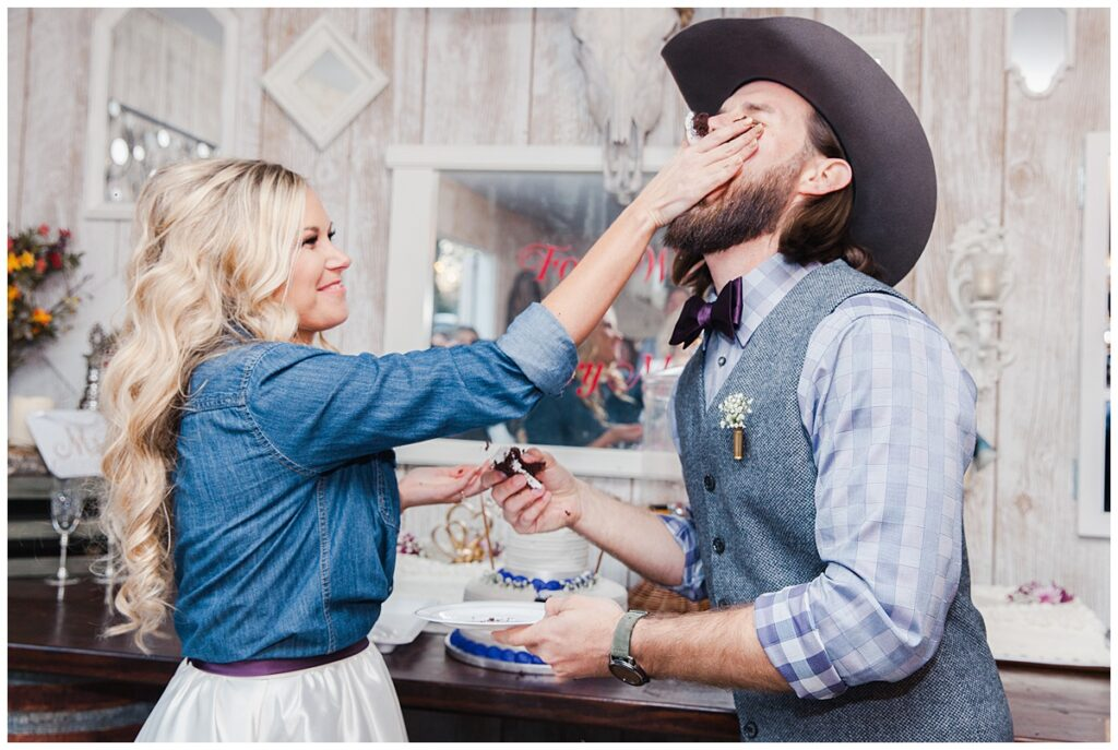 Bride smashes cake on groom's face for outdoor Texas styled wedding at Fort Worth Country Memorial Wedding Venue photographed by Dallas wedding photographer Jenny Bui of Picture Bouquet Studio.