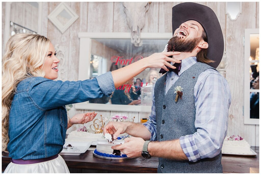 Bride smashes cake in groom's face for outdoor Texas styled wedding at Fort Worth Country Memorial Wedding Venue photographed by Dallas wedding photographer Jenny Bui of Picture Bouquet Studio.