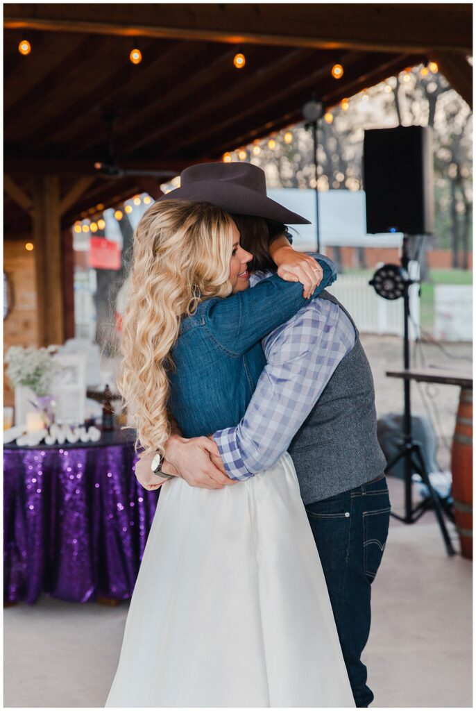 Texas styled bride and groom's first dance for outdoor Texas styled wedding at Fort Worth Country Memorial Wedding Venue photographed by Dallas wedding photographer Jenny Bui of Picture Bouquet Studio.