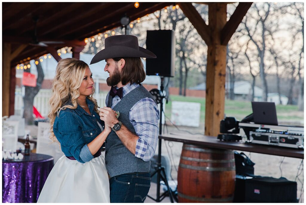 Texas styled groom and bride's first dance for outdoor Texas styled wedding at Fort Worth Country Memorial Wedding Venue photographed by Dallas wedding photographer Jenny Bui of Picture Bouquet Studio.