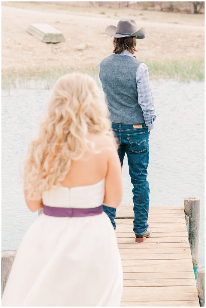 Bride in white dress and purple sash approaching groom for outdoor Texas styled wedding at Fort Worth Country Memorial Wedding Venue photographed by Dallas wedding photographer Jenny Bui of Picture Bouquet Studio.