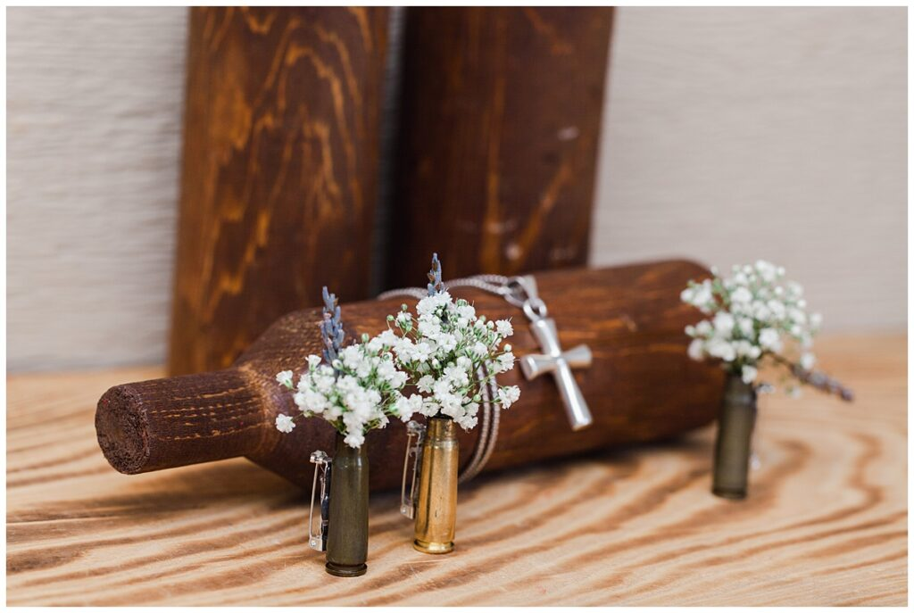 Wedding details of groomsmen's boutonnieres made from bullet shells for outdoor Texas styled wedding at Fort Worth Country Memorial Wedding Venue photographed by Dallas wedding photographer Jenny Bui of Picture Bouquet Studio.