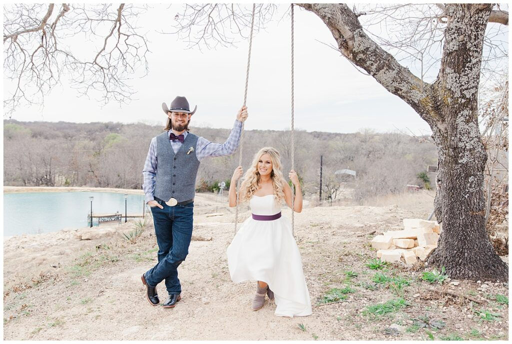 Texas styled groom stands next to bride in cowboy boots for outdoor Texas styled wedding at Fort Worth Country Memorial Wedding Venue photographed by Dallas wedding photographer Jenny Bui of Picture Bouquet Studio.