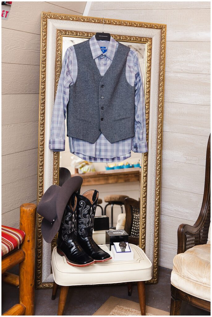 Groom's oufit, wedding day cowboy hat and boots for outdoor Texas styled wedding at Fort Worth Country Memorial Wedding Venue photographed by Dallas wedding photographer Jenny Bui of Picture Bouquet Studio.