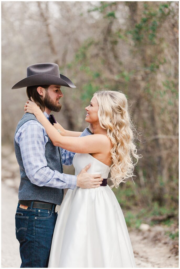 Texas styled bride and groom dances in pathway for outdoor Texas styled wedding at Fort Worth Country Memorial Wedding Venue photographed by Dallas wedding photographer Jenny Bui of Picture Bouquet Studio.