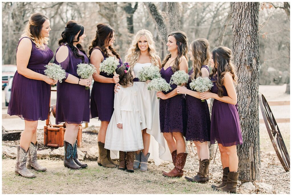 Texas styled bridesmaids and bride poses with baby's breath bouquets for group photo for outdoor Texas styled wedding at Fort Worth Country Memorial Wedding Venue photographed by Dallas wedding photographer Jenny Bui of Picture Bouquet Studio.