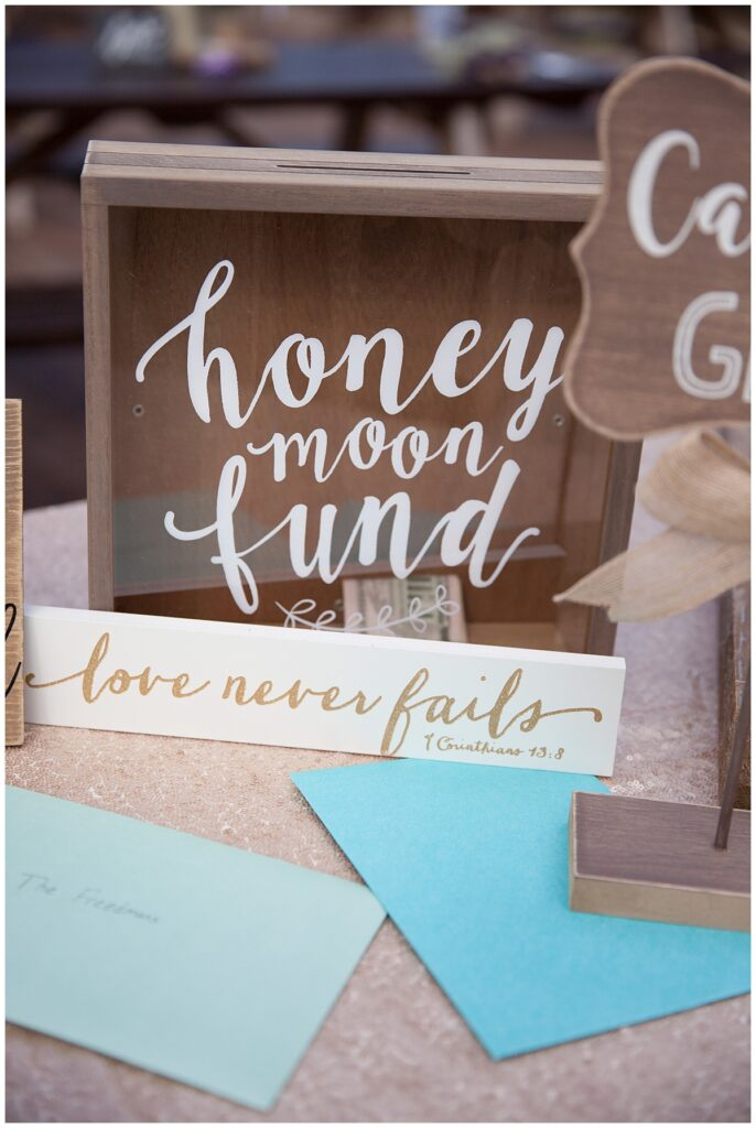 Wedding detail of honeymoon fund box for outdoor Texas styled wedding at Fort Worth Country Memorial Wedding Venue photographed by Dallas wedding photographer Jenny Bui of Picture Bouquet Studio.