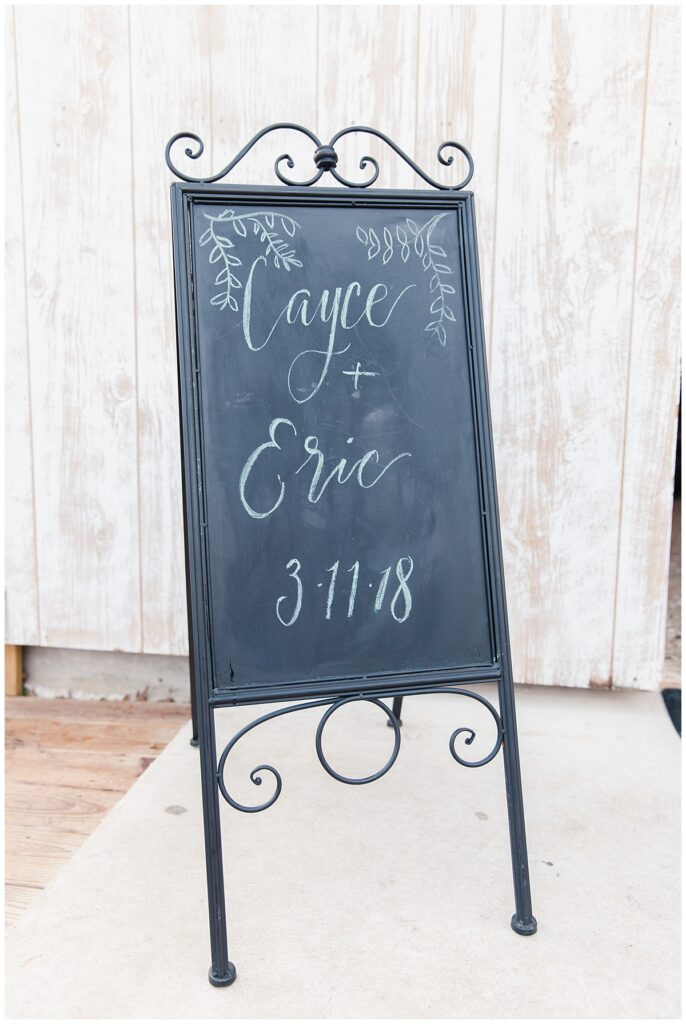 Wedding detail of name board for outdoor Texas styled wedding at Fort Worth Country Memorial Wedding Venue photographed by Dallas wedding photographer Jenny Bui of Picture Bouquet Studio.