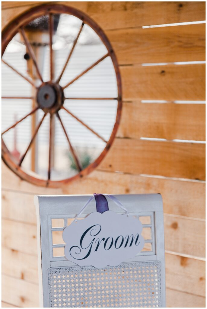 Groom's chair for outdoor Texas styled wedding at Fort Worth Country Memorial Wedding Venue photographed by Dallas wedding photographer Jenny Bui of Picture Bouquet Studio.