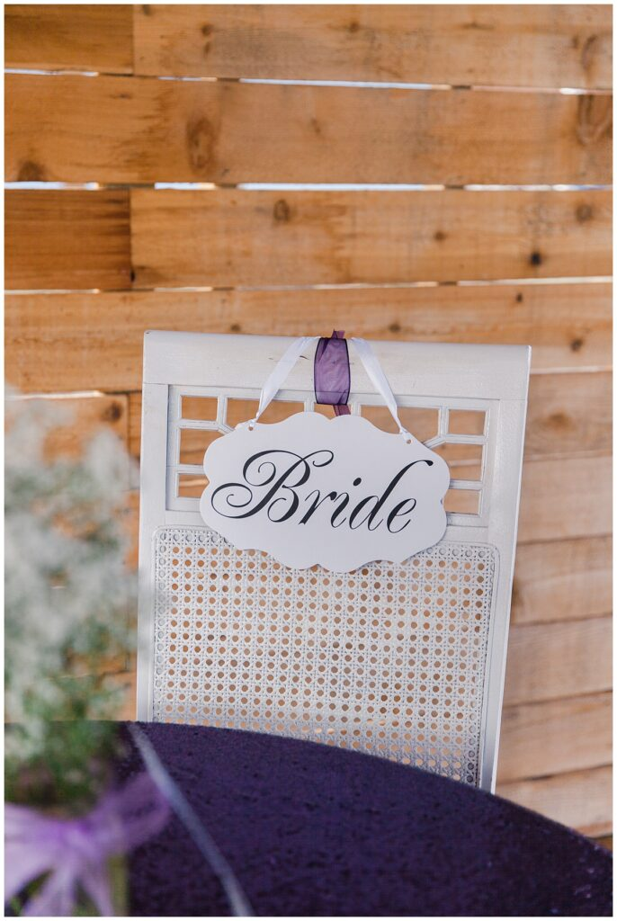 Bride's chair for outdoor Texas styled wedding at Fort Worth Country Memorial Wedding Venue photographed by Dallas wedding photographer Jenny Bui of Picture Bouquet Studio.