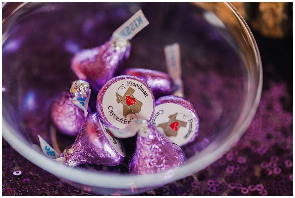 Customized Hershey kisses for wedding day decoration for outdoor Texas styled wedding at Fort Worth Country Memorial Wedding Venue photographed by Dallas wedding photographer Jenny Bui of Picture Bouquet Studio.