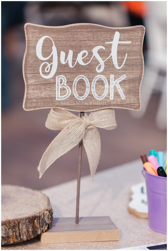 Guest book sign in sign for outdoor Texas styled wedding at Fort Worth Country Memorial Wedding Venue photographed by Dallas wedding photographer Jenny Bui of Picture Bouquet Studio.