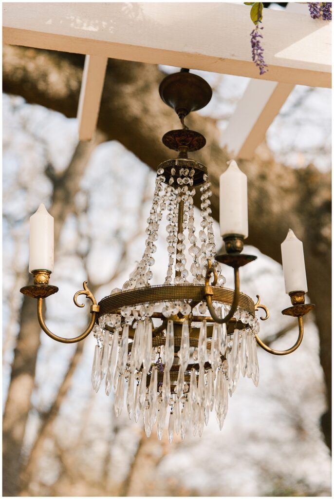 Wedding chandelier for ceremony for outdoor Texas styled wedding at Fort Worth Country Memorial Wedding Venue photographed by Dallas wedding photographer Jenny Bui of Picture Bouquet Studio.
