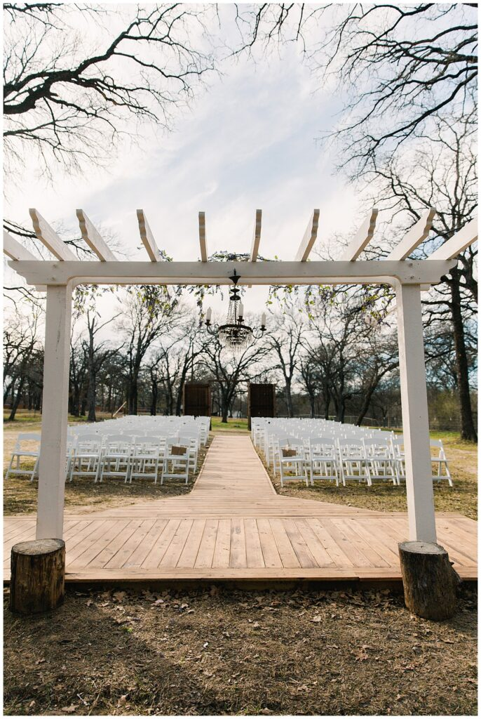 Wedding ceremony set up for for outdoor Texas styled wedding at Fort Worth Country Memorial Wedding Venue photographed by Dallas wedding photographer Jenny Bui of Picture Bouquet Studio.