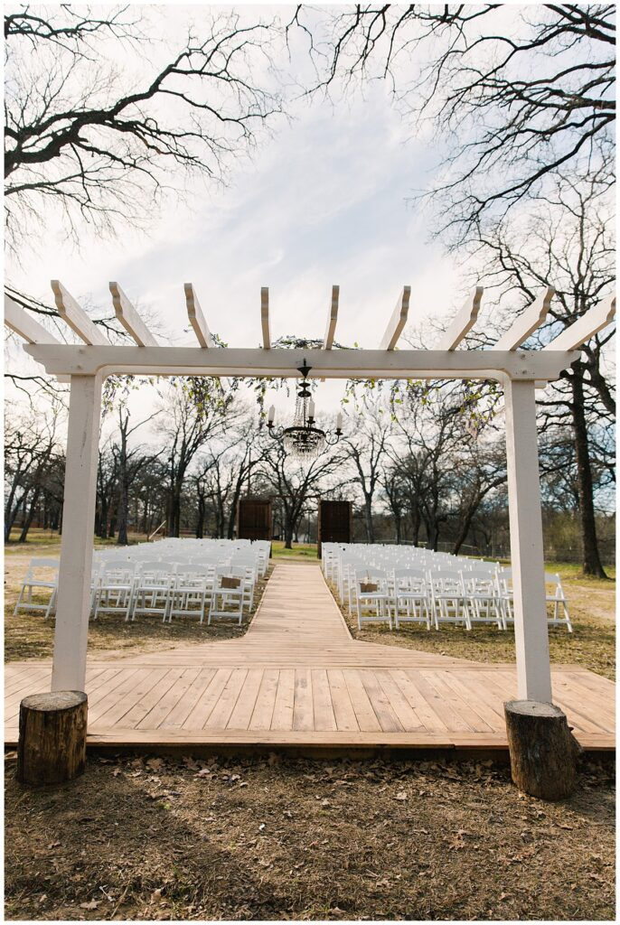 Wedding day ceremony set up for outdoor Texas styled wedding at Fort Worth Country Memorial Wedding Venue photographed by Dallas wedding photographer Jenny Bui of Picture Bouquet Studio.