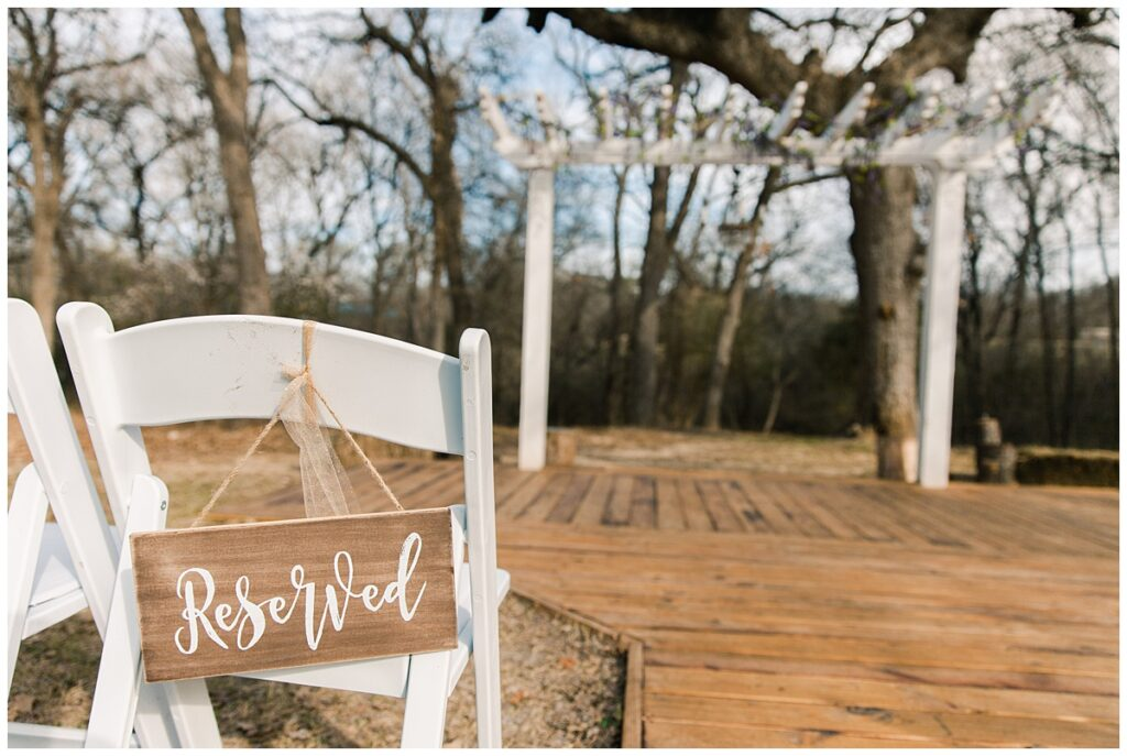 Wedding ceremony details for outdoor Texas styled wedding at Fort Worth Country Memorial Wedding Venue photographed by Dallas wedding photographer Jenny Bui of Picture Bouquet Studio.
